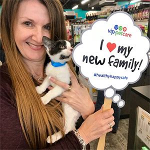 Woman with kitten and sign saying I love my new family!